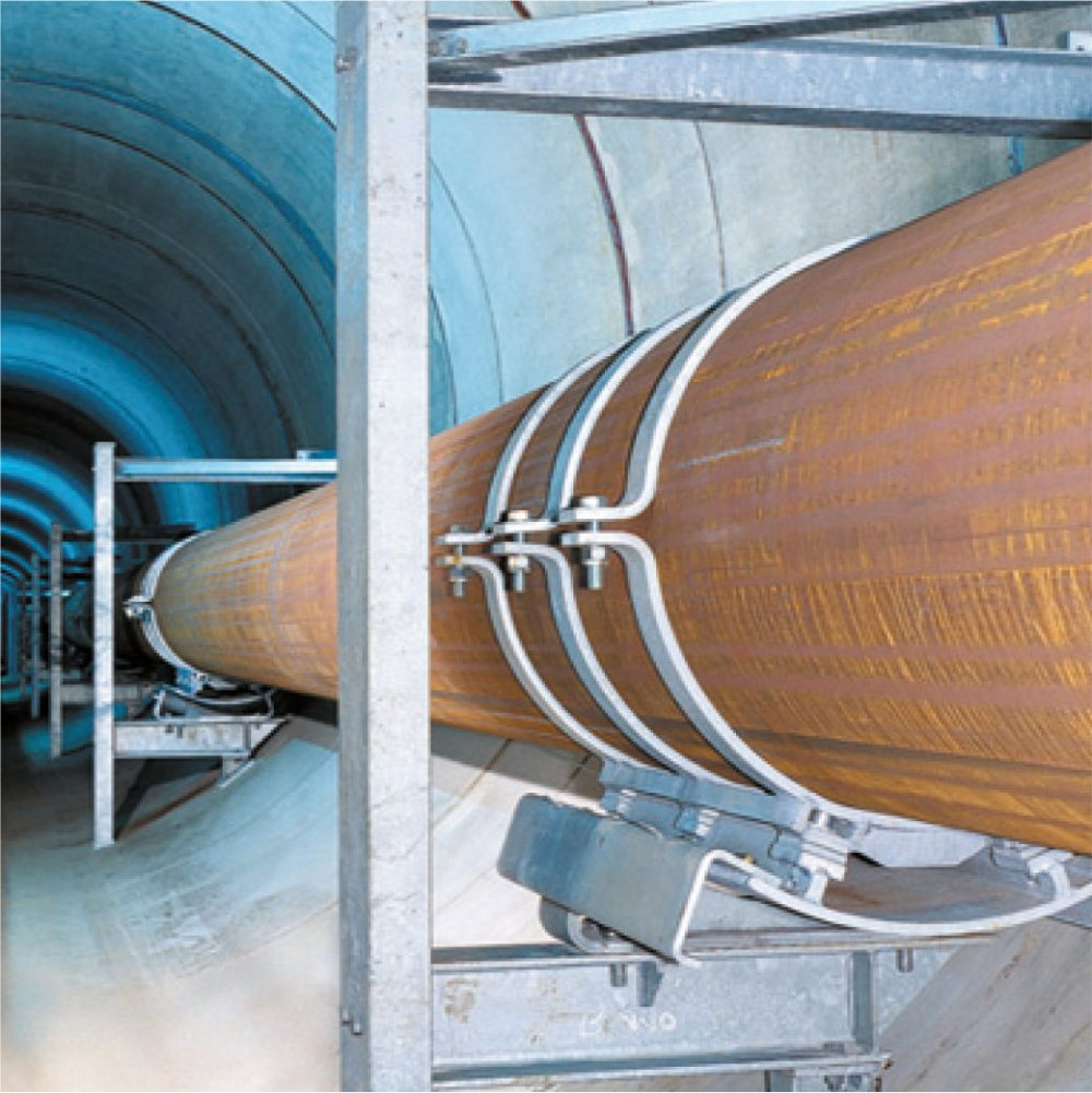 Cryogenic pipe supports, roller bearings and pipe saddles by